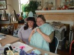 """1 Kimberly and Jan """"modeling"""" baby hat andblanket"""