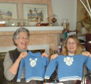 "Jean and Sarah showing Jean's ""twin"" sweaters"