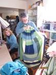 Marsha showing her latest log cabin creation
