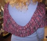 The garment has a beautifuldrape.