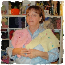 Helen with knitted gifts of love!