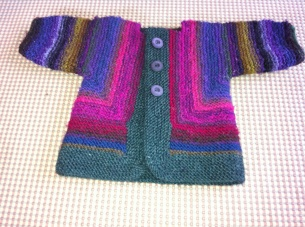 "5) Baby Surprise ""folded/molded"" into sweater!"