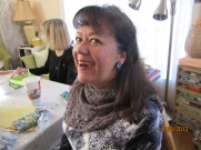 Kimberly's handknit cowl is enhanced with Jan's gift of glass earrings