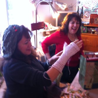 The BD girl with her pal Kimberly showing off one of her latest in knitting.